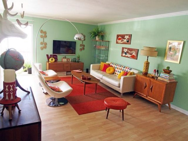 Mint Green Walls Of This Mid Century Modern Living Room Are Balanced With A Red Rug