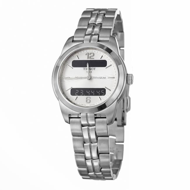 This womans silver dial watch by Tissot features a traditional analog display, giving it a classic elegance, but is also equipped with a convenient digital display option. This Swiss-made titanium watch is water resistant up to 330 feet.