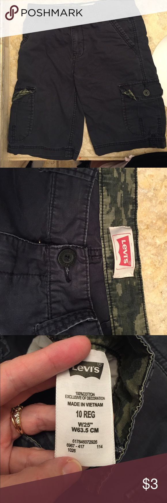 Boys Levi's dark gray cargo shorts size 10 reg These Levi's boys cargo shorts are in good condition! They are in dark gray with camo inside band however there is NO adjustable band!!! These fit true to 8-10! The back two pockets are missing buttons (see pics) and low price reflects it. You can easily sew those on or leave off for your boy to fill up with whatever he finds on his adventures!!! 🐍🐢🐸 they were well taken care of..smoke free and no pet hair! Levi's Bottoms Shorts