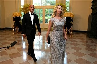 Laurene Powell Jobs and former Washington mayor Adrian Fenty arrive at a State Dinner in honor of Prime Minister Lee Hsien Loong of Singapore at the White House in Washington on August 2, 2016. / AFP / YURI