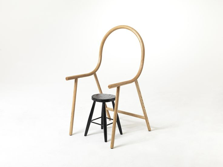 'arm' is designed to fit over any everyday seat to create a completely new chair, cloaked in the signified history and value of the bent oak form.