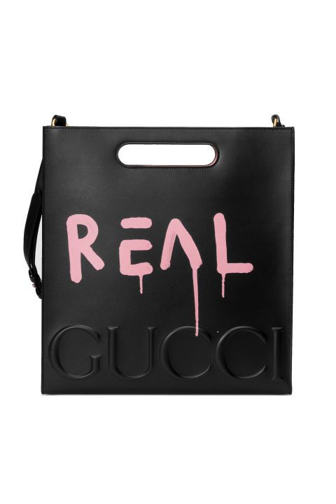 Gucci GucciGhost Leather Tote  Let the world know it's real.  Gucci's collaboration with artist Trouble GucciGhost Andrew this season adds an ironic and fresh twist on the Italian brand's iconography.