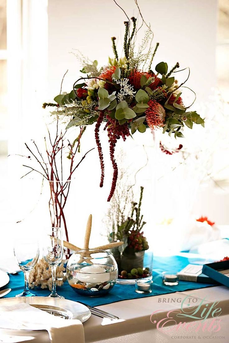 Under the sea table setting with flowers, star fish and coral