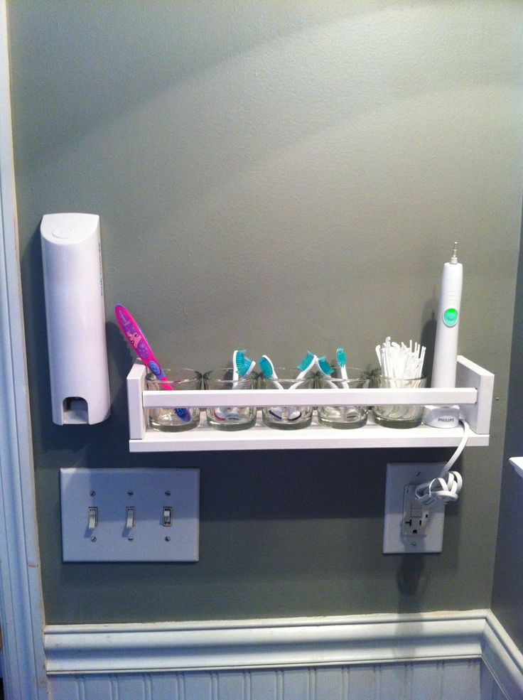 "Dental Care station for downstairs half bath. IKEA spice rack (painted), Walmart glass votive holders for sonicare heads and flossers, secured sonicare base with adhesive tape, pushpaste toothpaste dispenser. I want to hear ""no cavities"" every checkup!!!"