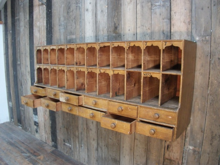 """A painted pine wall or desk mounted bank of 24 pigeon holes with 12 drawers below.   Formely used in a solicitors office.   Last half of ther 19th Century,Welsh borders .   6ft 6"""" long by 2ft 4"""" tall and 1ft 8"""" deep.  £ 850 inc VAT"""
