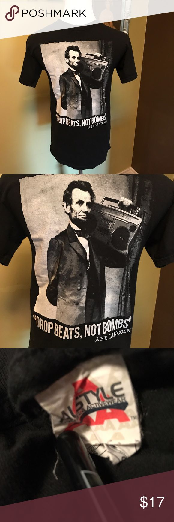 "100% Cotton Abraham Lincoln T-Shirt In Black Black t-shirt in 100% cotton with Abraham Lincoln on front holding a boom box and Abe's most famous quote, ""Drop beats, not bombs."" It's true. Google it. Armpit-to-armpit 17"", sleeve 7"" and length 24"". Please let me know if you need more pix or have any questions. All of my items come from a smoke/pet free home. I'm ready to get rid of everything so please make me an offer. Or better yet, bundle it, save more! Shirts Tees - Short Sleeve"