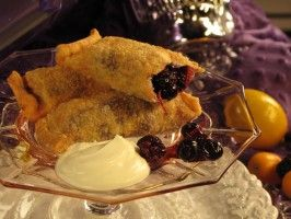 Black and Blueberry Dumplings with Vanilla Ice Cream and Chocolate Sauce from CookingChannelTV.com