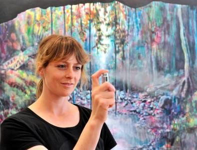 Dunedin artist Anya Sinclair (36) sprays the perfume that inspired  the Never & Forever piece exhibited at the Community Gallery for the...