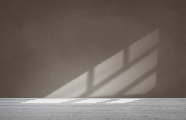 Download Brown Wall In An Empty Room With Concrete Floor For Free