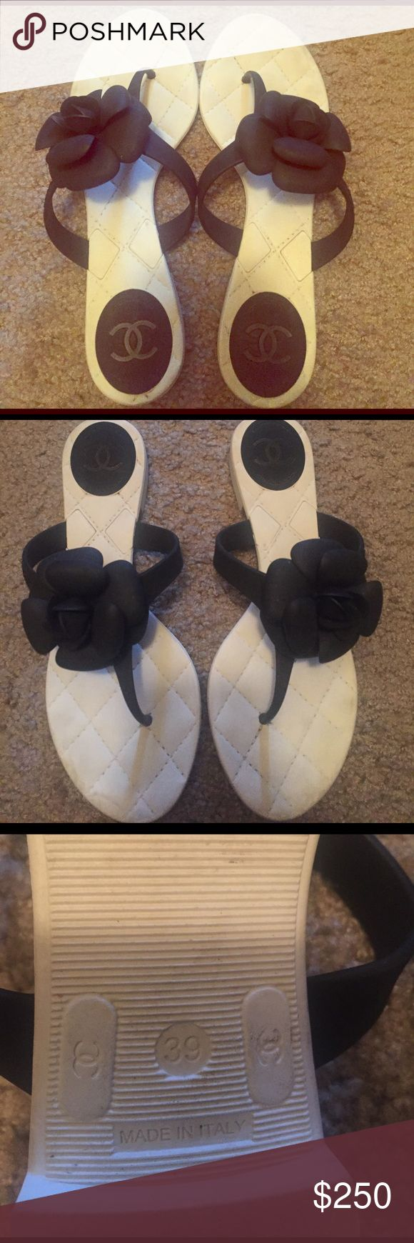 Authentic Chanel flip flips White rubber flip flops with black rubber flower. Used. Bought at nordstroms. CHANEL Shoes Sandals