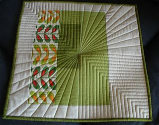 I love the quilting on this! It's so three-dimensional and gives the quilt a sense of perspective