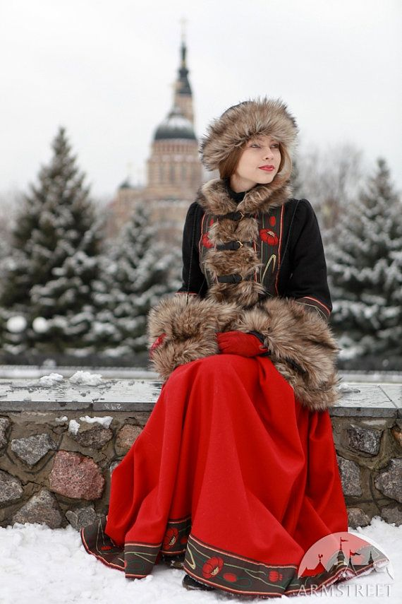 Short fur coat Russian Seasons with hat and muff  Cold-weather short coat bordered with fake fur refers to the Russian national costume theme. The stand-up collar, body conscience silhouette, bell sleeve, wide jacquard trim finishing - the configuration is typical for the classic overcoat of The Snow Maiden from Russian fairy tales. But intense colours and pomegranate pattern on the trim make this coat more bright and more contrasting. The coat has five leather straps with moulded brass…