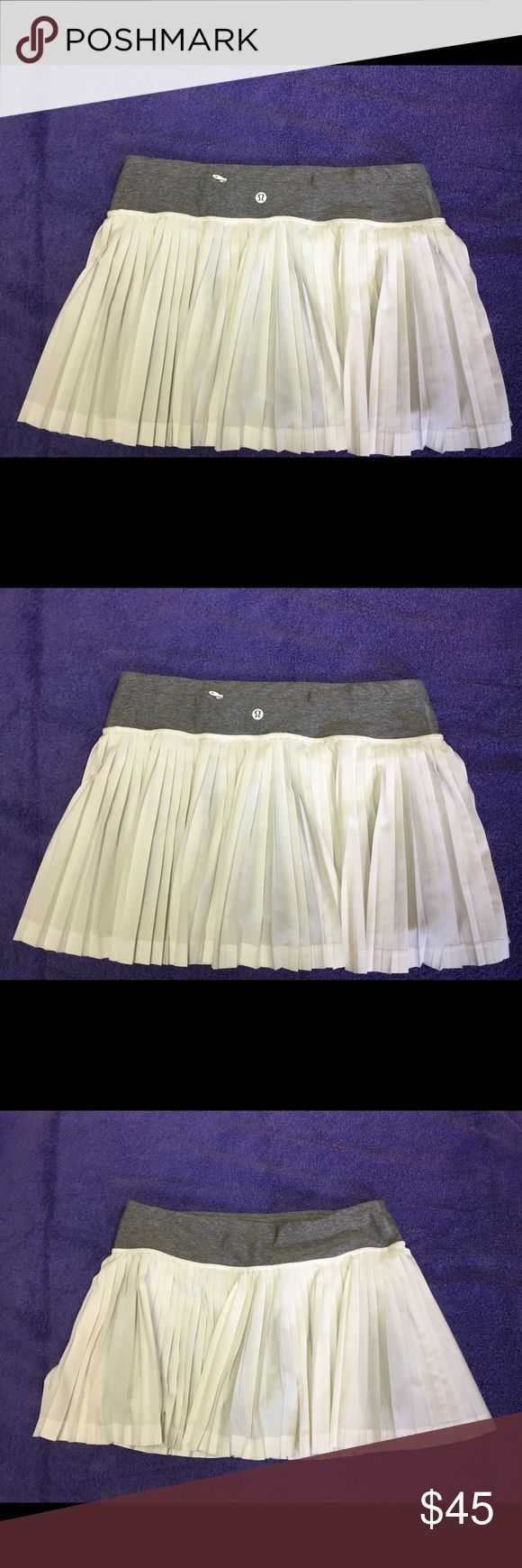 Lululemon skirt . Size 6 white and gray . White and grey tennis skort.  Lululemon-Size 6; material - polyester, nylon and Lycra; Waist - 15in., Length-13in., Shorts inseam-3 1/2in.  Zippered pocket for key or change. No damage, been worn twice. lululemon athletica Shorts Skorts