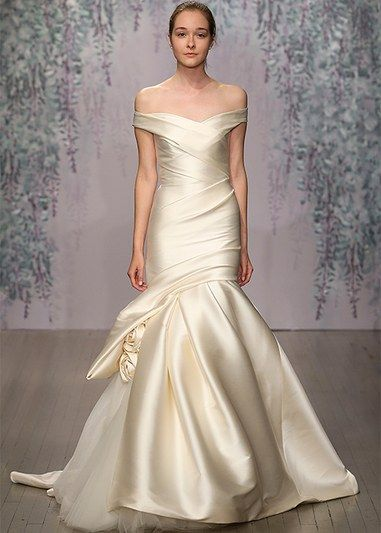Have a particular area of your body you want to show off in your wedding dress? (Like your arms or back?). We know the perfect dress for you - click to see!
