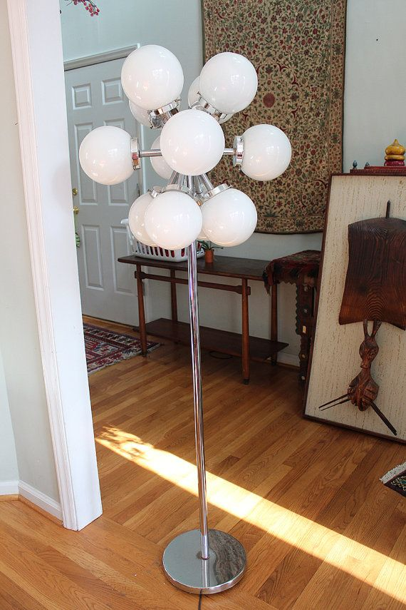 NOTE: If you purchase this item, it will not ship until February 8. Please feel free to purchase this item to make sure its yours, and I will ship it on February 8, when my shop reopens after vacation.  Here is a really nice 12-light Sputnik floor lamp, probably from the 1970s. The switch has three settings so that either 4, 8, or all 12 lights are lit. Its quite a bit heavy, with a consider base to counterbalance the globes at the top. I havent found a makers name on it. In excellent…