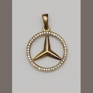 A diamond-set gold pendant resembling a Mercedes-Benz automobile badge. (Bonhams)