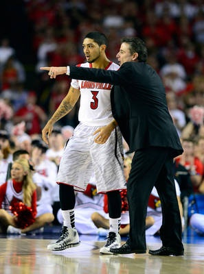 Master and pupil Louisville head coach Rick Pitino talks to guard Peyton Siva (3) during the second half.    Bob Donnan-USA TODAY Sports - USA TODAY