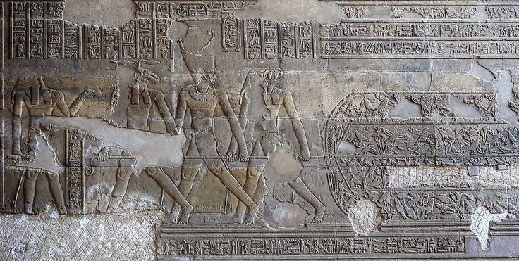 """The ritual of the """"Net Hunting"""". The King (the Emperor Commodus Antoninus, wearing the Red Crown), Khnum (ram-headed, at left), and Horus (falcon-headed, at right) trapping birds and fishes in the..."""