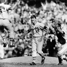Brooks Robinson, Dave McNally, and Andy Etchebarren celebrate 1966 World Series sweep!