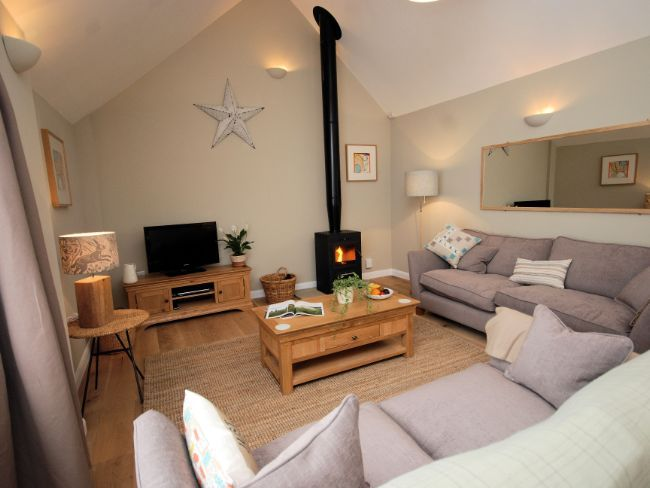 Open plan lounge with woodburner