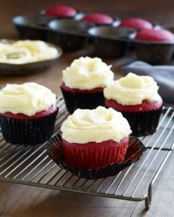 Red Velvet Cupcakes with Orange Buttercream Frosting that's made with beets for coloring instead of awful food coloring/dyes!!