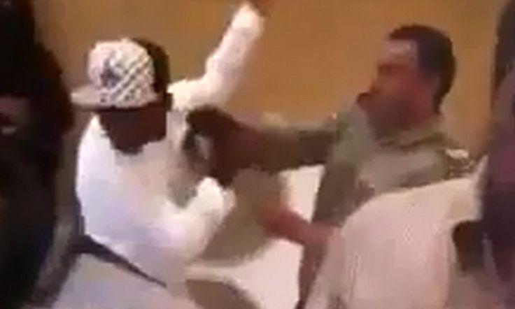 Saudi Arabian official filmed beating foreign workers with a belt as they visit passport office to get their visas.
