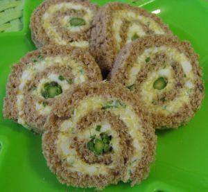 Making pinwheel egg salad tea sandwiches