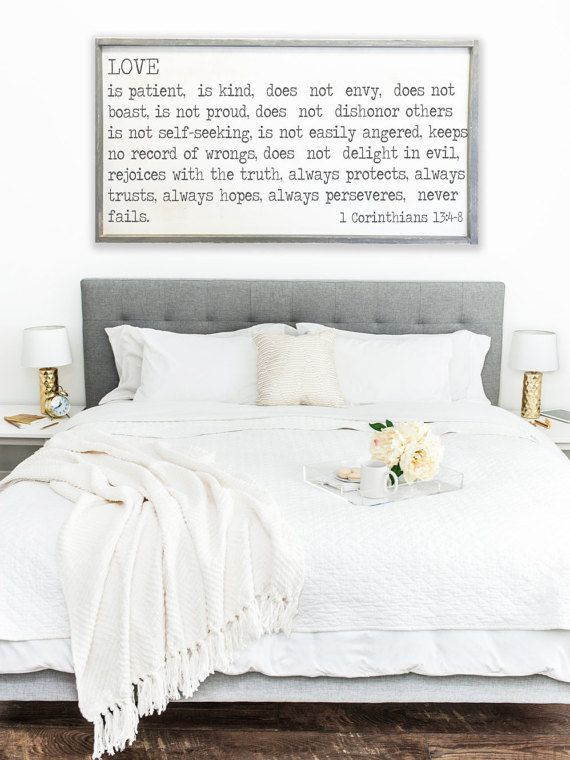Framed wood painting or sign above headboard
