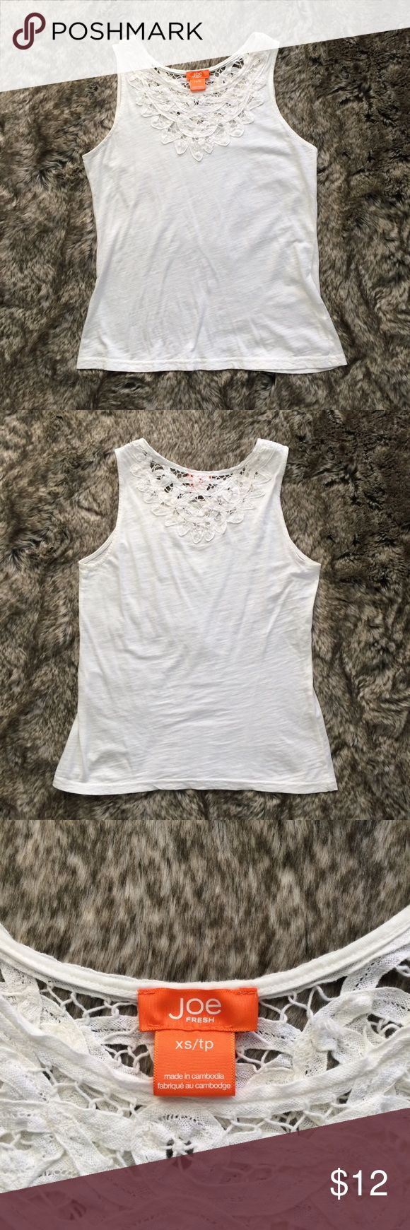 "Joe Fresh Lace Crochet Tank Top Cute and soft Joe Fresh white tank top with a crocheted neckline detail. Very good condition.  16"" armpit to armpit, 23"" shoulder to hem. Thanks for looking! Joe Fresh Tops Tank Tops"
