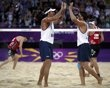 Brazil's Ricardo Santos (front L) and Pedro Cunha celebrate after defeating Canada's Joshua Binstock and Martin Reader during their men's preliminary round beach volleyball match at Horse Guards Parade during the London 2012 Olympic Games August 1, 2012. REUTERS/Marcelo del Pozo (BRITAIN - Tags: SPORT VOLLEYBALL OLYMPICS) - http://www.PaulFDavis.com/success-speaker (info@PaulFDavis.com)