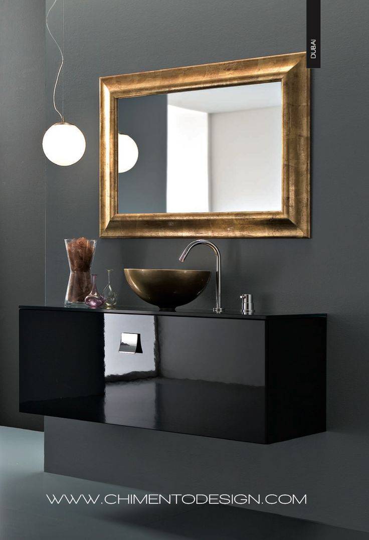 http://www.chimentodesign.com/site/collezione/741-2/   Frontale laccato nero luci- do. Top in cristallo nero lucido per lavabo da appoggio. Lavabo soprapiano in finitura oro anticato.   Black lacquered front. Glossy black crystal top for the surface-mountedwashbasin. Countertop washbasin in an- tique goldfinish