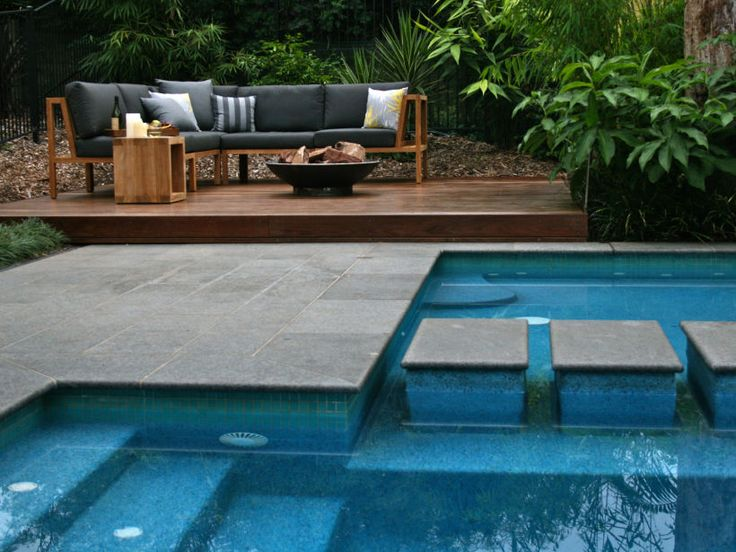 Eco Outdoor Raven granite paving used as coping around resort style free form pool. Eco Outdo or | Fluid Design | livelifeoutdoors | Raven granite tiles | Alpine dry stone walling | Outdoor design | Natural stone walling + flooring | Garden design | Outdoor paving | Outdoor design inspiration | Outdoor style | Outdoor ideas | Paving ideas | Garden ideas | Contemporary garden ideas | Contemporary pool ideas | Floor tiles | Outdoor tiles | Resort style garden | Outdoor entertaining | Luxury…