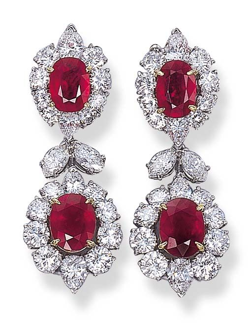 A PAIR OF RUBY AND DIAMOND EAR PENDANTS, BY VAN CLEEF & ARPELS   Each set with a detachable oval-cut ruby and circular and pear-shaped diamond cluster to the marquise-cut diamond two-stone surmount suspended from a top of similar design, the rubies weighing 1.45, 2.48, 1.64 and 2.43 carats  Signed Van Cleef & Arpels, N.Y., no. 566572