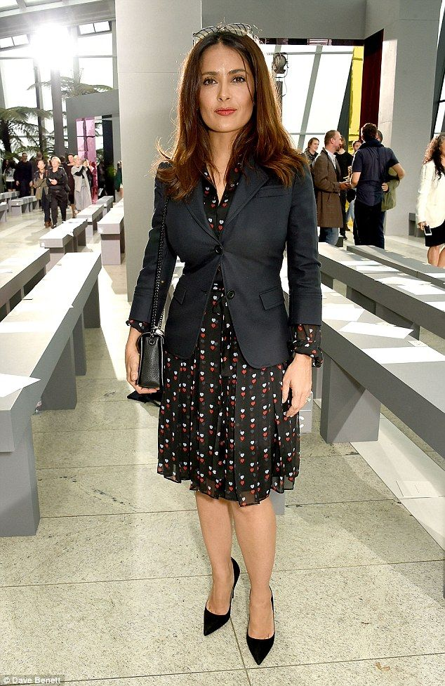 Sophisticated: Salma Hayek, 49, was seen cutting a very demure figure at the Christopher Kane Spring / Summer 2016 show during London Fashion Week on Monday