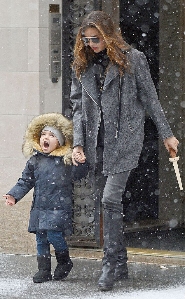Adorable alert// Miranda Kerr's little cutie Flynn tries to catch some snowflakes//