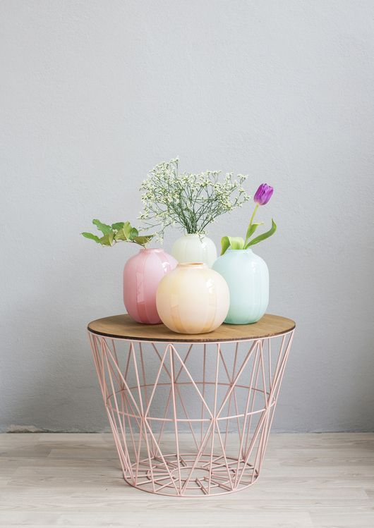 Wire table ||||| I bet you could make this with a wooden disk (not sure where you'd find that without making one) or plate/tray on top of a spray painted waste basket.