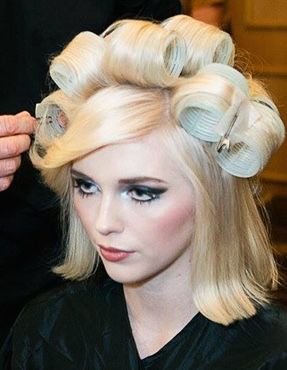 Setting her hair in big rollers so sexy