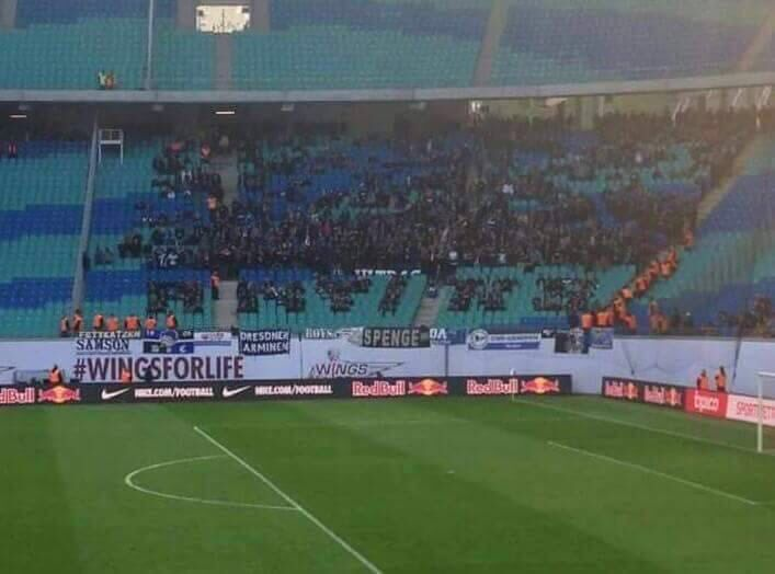 """Red Bull Leipzig banned Arminia Bielefeld fans from bringing large flags a few weeks ago so they spelled out """"ANTI RB"""" themselves"""