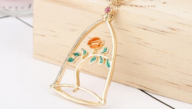 Affordable Enchanted Rose Crystal Pendant for just £7.00 - Jewellery (Gift idea) This Enchanted Rose Crystal Pendant is worthy of a princess      Create your own fairy tale with this cute necklace      Gold tone finish has red and green touches, plus a small pink crystal      Presented in its own luxury velvet pouch      Pendant size: 2.4cm x 3.7cm      Chain length: 20cm      Look charming in an Enchanted Rose Crystal Pendant for 7 pounds - save 76% BUY NOW for just £7.00