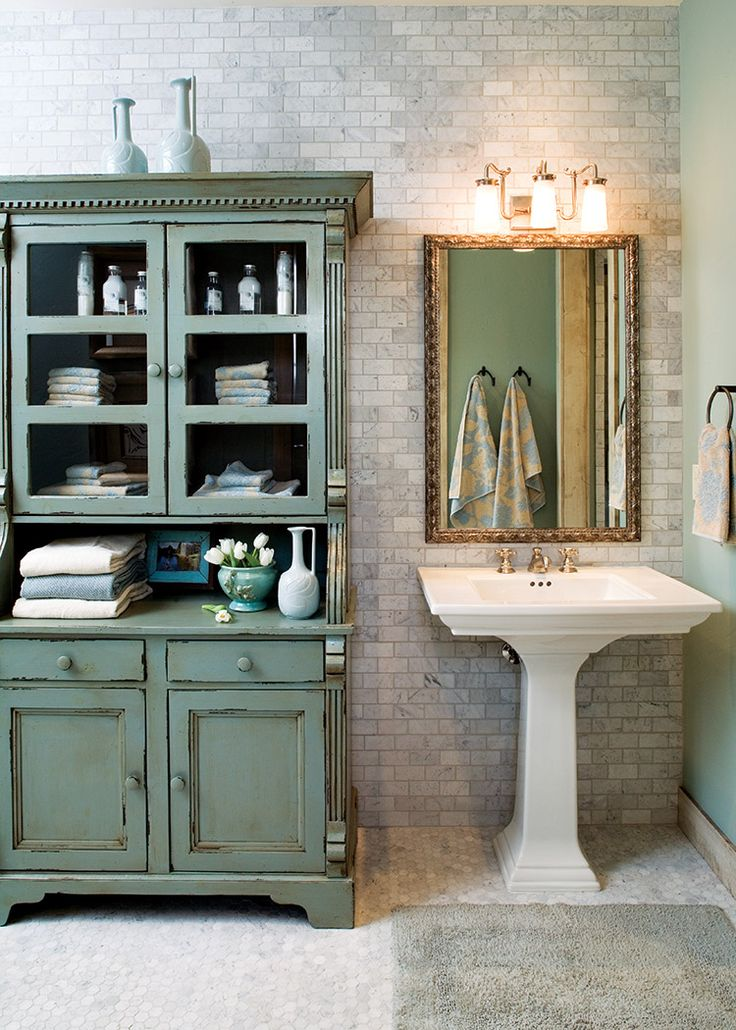 Beautiful antique style pedestal sink paired with rustic storage hutch #bathroom