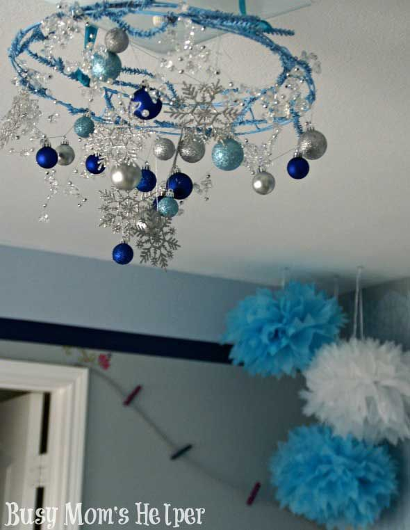 How about a frozen inspired chandelier ---- 25 Cute Frozen Themed Room Decor Ideas Your Kids Will Love
