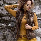 Купить или заказать Валяный жилет  'Дымка' в интернет-магазине на Ярмарке Мастеров. Валяный жилет 'Дымка ' Свалян из высококачественной шерсти меринос ( 18 мк). Строгий стильный жилет в Серо-черных тонах, с трехмерным декором. Прекрасно сочетается с одеждой придавая нарядность любому повседневному образу. Жилет без застежек, очень теплый, но в тоже время легкий. При желаниий можно заказать другой размер и расцветку.