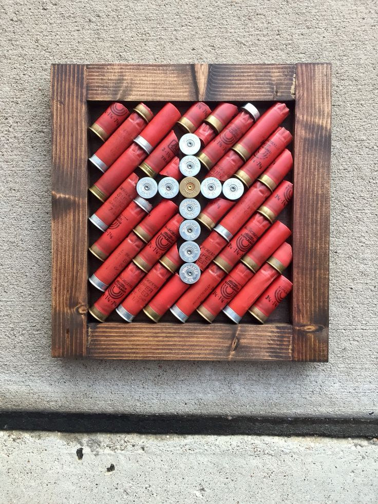DIY project. All you need is: wood, nails, hammer, wood stain, empty shotgun shells, and some hot glue