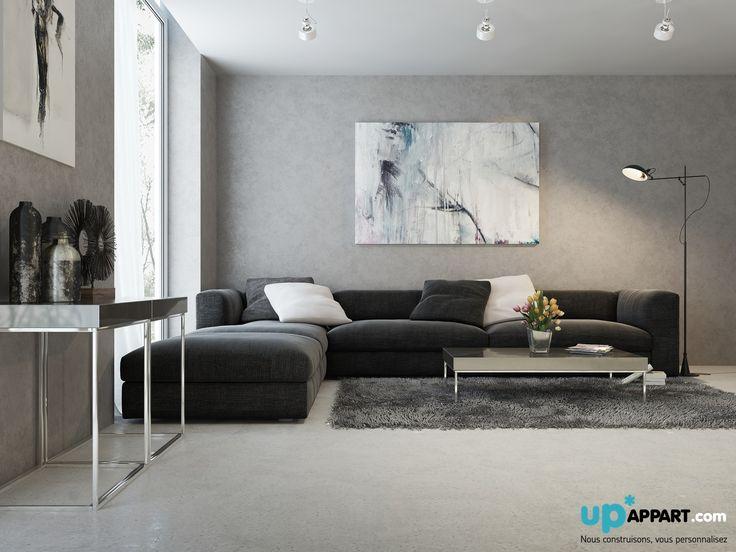 Des tons gris, du béton, un salon simple et élégant.