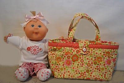 Repurposing thift store baby clothes into cabbage patch doll clothes and sewing baby socks to fit the dolls.