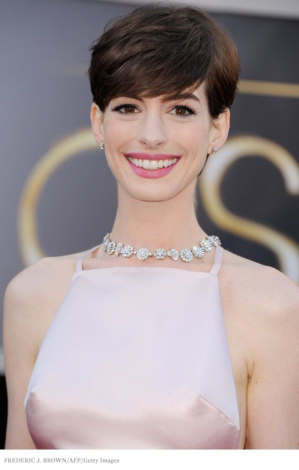 Actress. Singer. Newly minted gamine (check out the Audrey Hepburn boy cut!). And now, Oscar winner. She's come a long way from The Princess Diaries.