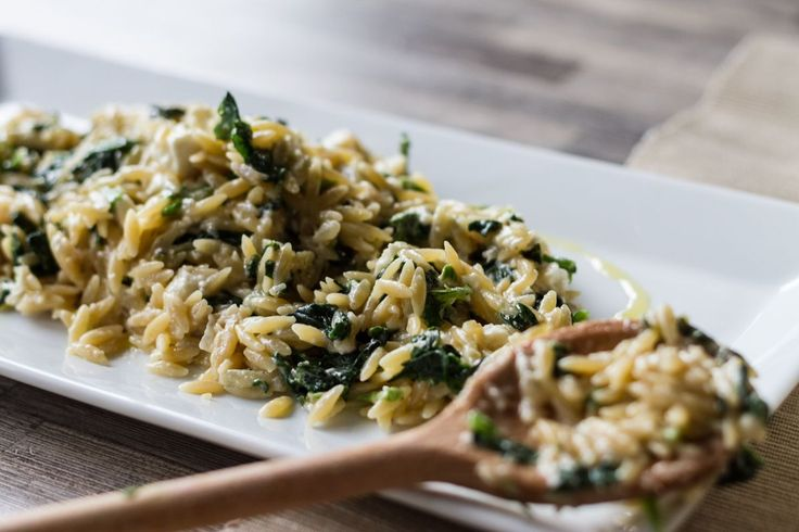 Spinach and Feta Creamy Orzo. Sauté the onions in a pot with some olive oil, over a low heat for at least 8 minutes. In another pot, warm the broth. As soon as the onion has softened, add the orzo and sau...
