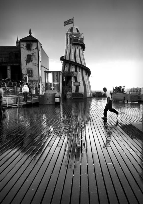 Rainy Day on the Pier 4 by Jerry Webb, a fantastic Brighton Photographer.