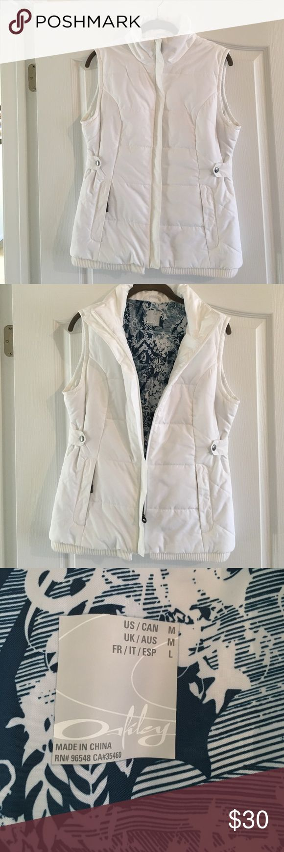 Oakley white vest (like New) Cute white Oakley vest with blue and white lining (like new) Oakley Jackets & Coats Vests