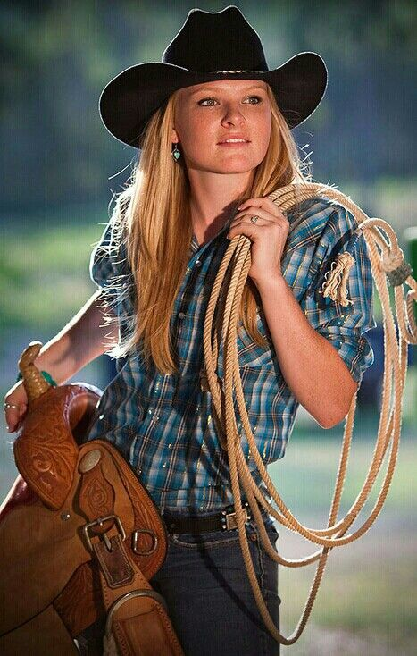Travel Fashion & Style Features - A Beautiful Cowgirl Wearing a Stylish Cowboy Hat, Cowboy Shirt & Jeans Perfect for Rugged Adventure Travel ... See more @gr8traveltips